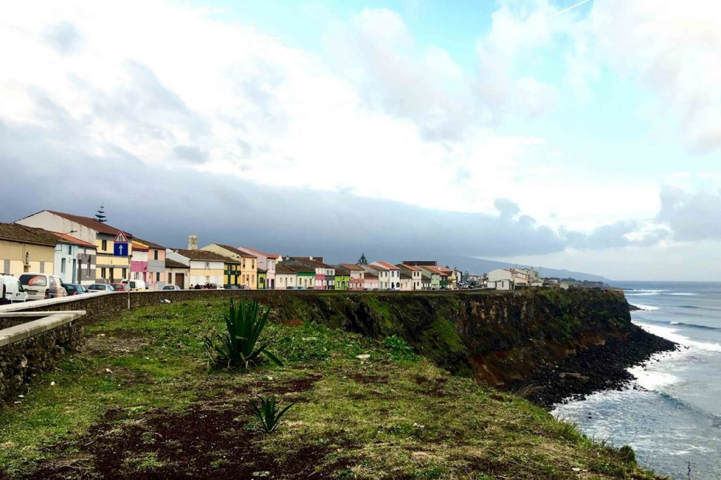 Colorful homes on a cliff in the Azores.