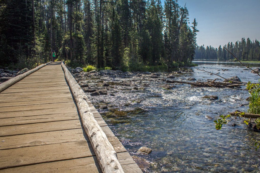 If you're thinking about a road trip or other travel in the American West, chances are you've got some national parks on your radar. Montana and Wyoming alone are home to three of the most popular parks: Glacier, Yellowstone, and Grand Teton. Here are our tips on the top things to do in each national park and the towns nearby. Highlights include Old Faithful, Going-to-the-Sun Road, Jenny Lake, and the towns of Bozeman, Whitefish, and Jackson.