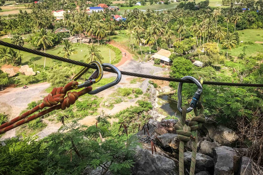 Looking for unique things to do in Kampot, Cambodia? Give rock climbing a try! Climbodia takes beginners on trips that include scrambling, top roping, via ferrata, caving, and abseiling/rappelling in the karst mountains outside of Kampot. Our Climbodia review covers each part of their Discovery Tour, as well as all the safety precautions taken.
