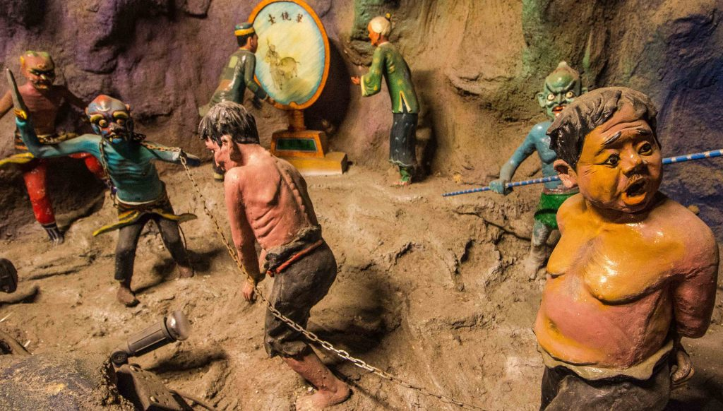 Exploring Buddhist Hell at Singapore's Haw Par Villa