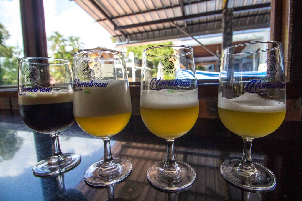 Most people who travel in Laos drink just one beer during their trip: the ubiquitous Beerlao. But new microbreweries are finally opening up, mainly in Vientiane, and this guide to craft beer in Laos covers almost all of them. When you visit, mix things up a little by exploring some of the smaller breweries in Laos.