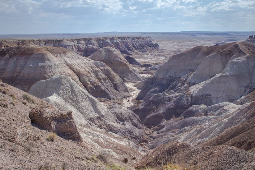 Small canyon between colorful badland hills.