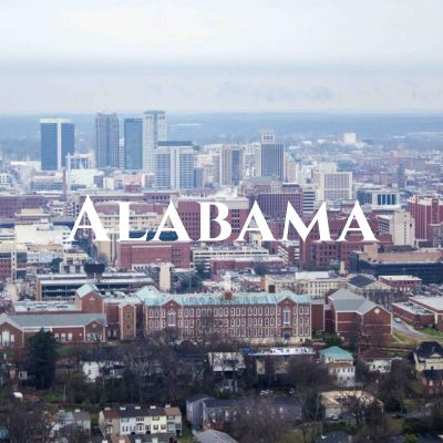 """""""Alabama"""" written across an aerial photo of a city, featuring many red buildings."""
