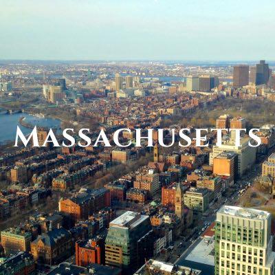 """""""Massachusetts"""" written across an aerial photo of a city."""