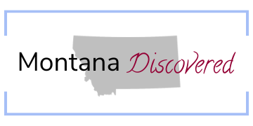 """The words """"Montana Discovered"""" written across a silhouette of Montana, all inside a light blue rectangle."""