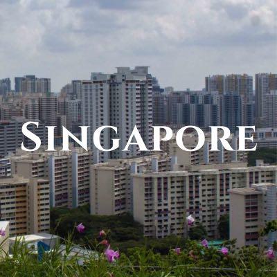 """Singapore"" written across a photo of dense skyscrapers."