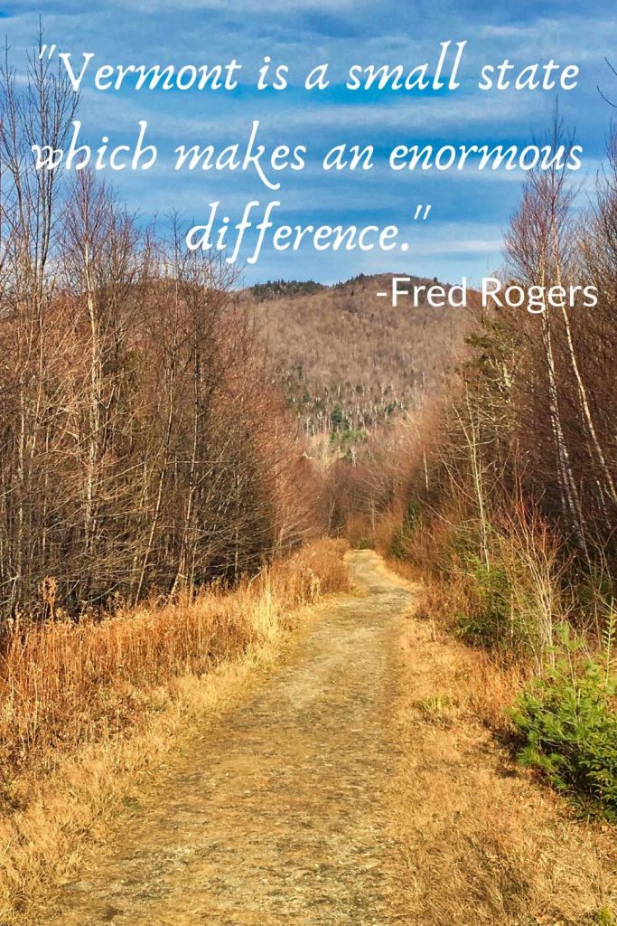 """Tree-lined path to a hill, behind the quote, """"Vermont is a small state which makes an enormous difference. -Fred Rogers."""""""