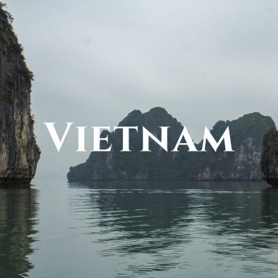 """""""Vietnam"""" written across a photo of karst mountains rising out of the water."""